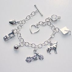 I want this!! The Twilight Charm Bracelet features seven carefully selected sterling silver charms, which represent important things or events from the Twilight Saga. An apple, an old pickup truck, a baseball, a motorcycle, a wolf, a graduation cap, and a wedding ring