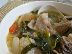 Filipino Recipe Sinigang na Baboy (Pork Spare Ribs in Sour Soup)  2 tbsp sinigang mix  1/2 lb pork spare ribs  1 medium onion; sliced  1 tomato; sliced  bunch kangkong leaves (river spinach)  2 tbsp patis
