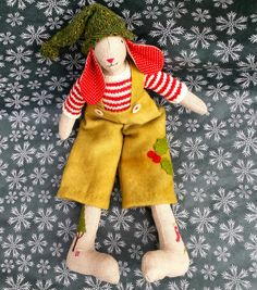 A Christmas Elf with hand-dyed felted wool dungarees and a tiny bobble hat the colour of fir trees.
