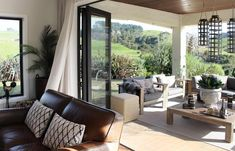 THE ELEGANT ENTREPRENEUR I MURIWAI - Lou Brown Dining Area, Oak, Trestles, Elegant, Custom Wine Cellars, Interior Design, Interior Design Brief, Reclaimed Oak, Wine Cellar