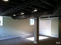 So this is just a basement, but instead of finishing the ceiling and enclosing the space more, they allowed it to feel more open and updated by doing a simple sealant/paint in black! Cheaper, easier, and in some basements, more practical!