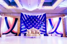 Festooned Blue Wedding Reception Stage, photo by Vek Photography