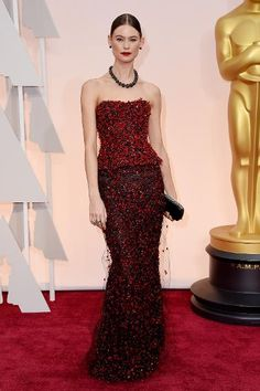Oscars' Best Beauty Looks | The elegant Behati Prinsloo wears a back low bun at the 2015 Oscars