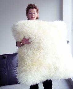 giant sheep skin cushion omg I want this pillow!