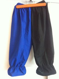 This is a pair of bloomers that can be worn at Renaissance Faires. It is 100% cotton. Made in duel colors of Black and Blue. It is size Small. The legs have elastic which create a flair at the end. The elastic is adjustable. This is a one of kind piece, but similar items can be made in a variety of colors and size by request.