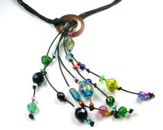 Bunch of beads, bunch of string, and a big round doohickey.