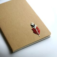 Feather hand embroidered moleskine pocket notebook by PoppyandFern, $12.00