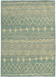 Material: Machine Made 100% Wool The Nomad collection provides a modern influence and authenticity to the collection's traditional, nomadic-inspired designs. Soft neutrals mimic the shades and texture