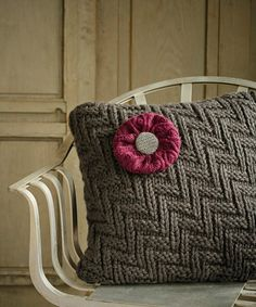 Turn an old sweater into a pretty decorative pillow that will make your home fell extra cozy.
