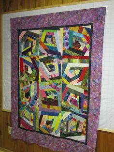 Scrappy Log Cabin Crazy Quilt - 2015.  Centered on a pentagon shape.  I turned the blocks according to the center shape's pointed end as I didn't want them all pointing in the same direction.  Definitely a stash buster.