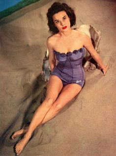 Actress Jean Peters in a purple swimsuit 1952 vintage photo