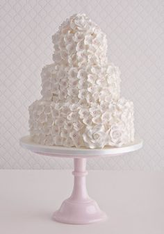 "'Hydrangea Cascade and Roses' wedding cake    : Madagascan vanilla  bean cake, Amedei Chuao chocolate buttercream, satab ribbon,  sugar hydrangea flowers and sugar roses.    (for alternatives please see 'Fillings & flavours')    Price as shown:  3 tiers (5"", 8"" & 11"")  £825 (stand not included)"