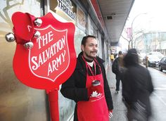 Season of giving: Blaine Desjarlais collects donations for the Salvation Army on Sixth Street outside Tim Hortons. The local kettle campaign fell a little short of its goals but organizers are still very pleased with the generosity of the donors. Tim Hortons, Westminster, Organizers, Kettle, Christmas Sweaters, The Outsiders, Campaign, Army, Goals
