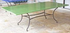 VERT CHATEAU LAVA STONE AND BLACK WROUGHT IRON TABLE