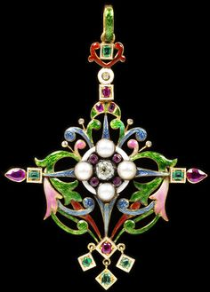 Renaissance revival pendant by Mrs. Philip Newman, circa 1890, English, gold and enamel set with diamonds, rubies, emeralds and half pearls.