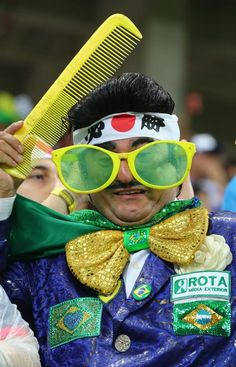 Cote D'Ivoire v Japan: Group C - 2014 FIFA World Cup Brazil - A fan enjoys the atmosphere prior to the 2014 FIFA World Cup Brazil Group C match between the Ivory Coast and Japan at Arena Pernambuco on June 14, 2014 in Recife, Brazil. (Photo by Jamie Squire/Getty Images)