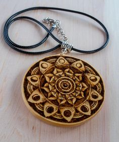 Gift for her for any occasion! This is a large circle handmade wooden pendant with original Moon cycles Mandala pyrography freehand art. 10 cycles of the Moon combine in a beautiful Mandala makes it great spiritual and meaningful gift for your girlfriend, yoga partner or teacher, anybody who appreciate original artwork jewelry and rustic, hippie and boho style. The pendant made from solid basswood and decorated with freehand pyrography work. The necklace has 18 (45.7 cm) faux leather braided…