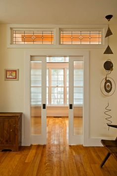 Bring Natural Light into the Home with Transom Windows : Great Farmhouse Transom Windows With Leaded Glass And Sliding Glass Door Next To Wall Art Above Wood Buffet On Wood Flooring Plus Decorative Accessories
