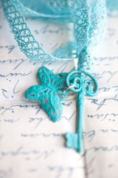 Turquoise Skeleton Key with butterfly.. I like the key but not the fabric chain.