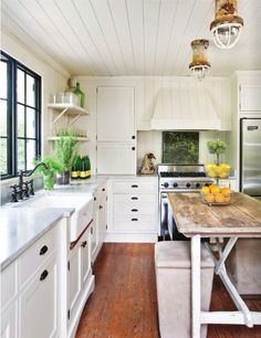 I love this kitchen - cabinets, ceiling, windows, sink, countertops and island