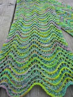 Holy Marie has a lovely take on the old feather & fan, inspired by a kayak trip. One of her FREE knitting patterns at her blog, at the link. She sells gorgeous pencil rovings on etsy, too.  (crib sheet = over 56 sts: 1&3=k  2=p 4=Knit 1*, k2tog, three times, (yo, k1) six times, k2tog, three times.  Or m1 instead of yo for a more solid increase