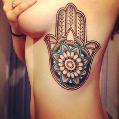 Hamsa tattoo- a symbol of protection, love and good fortune Tattoo Girls, Girl Rib Tattoos, Rib Tattoos For Guys, Tattoos On Side Ribs, Cute Girl Tattoos, Tattoo Designs For Girls, Hot Tattoos, Tattoos For Women, Woman Tattoos