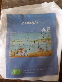 cross stich kit complete showing a seaside beach scene by MaddisonsRainbow on Etsy