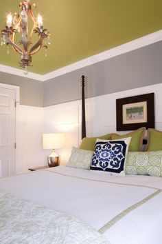 The paint color is called Georgian Silver 507-4 by Porter paints.     If you use Behr, Sage Gray 710-F and the green color on the ceiling is Behr Aspargus    Pieced the bedding together, duvet from ebay, quilt at end of bed Homegoods, Large Green pillows and blue pillow is from Pottery Barn, the others came from TJ Max.