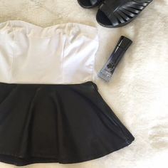 Faux Leather Peplum Top Dress this strapless faux leather peplum top to be edgy or girly. Either way it's super cute! This was only worn once for a few hours so it's in great condition. Kirra Tops