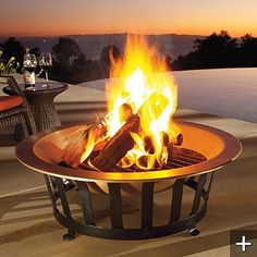 copper fire pit. sturdy. elegant. withstands outdoor year-round use. perfect for winter.