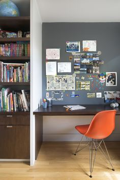 Upstairs, their son's bedroom features a built-in walnut bookshelf and desk. Smart details—like the magnetic paint in lieu of a bulletin board—help keep the space tidy. The chair is an Eames Molded Fiberglass Side Chair.