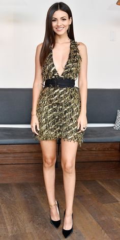 We can't get over Victoria Justice in this flirty ensemble: a plunging Milly mini dress with all over fringe and an ultra-flattering waist tie, gold drop earrings, bold black rings, classic pumps rendered in alternative satin, and (yes) gold anklets.