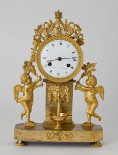 Часы каминные. Франция. Реймс. Часовой мастер Брокар. Около 1805 г.  Бронзовые фигурки двух амуров.