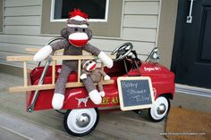 Red radio flyer wagon on front porch with monkey stuffed animal in it...