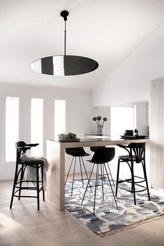 We proudly present this great make-over: We redesigned this Austrian flat. Look at this bright black and white dining room with bar stools and a great round lamp. We love the black and white mix and the bohemian flair.  Do you want to see the whole make over? Check out our website!
