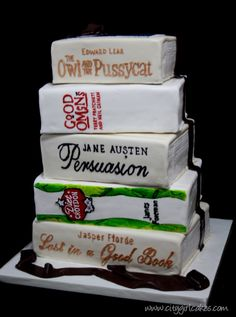 This is the prettiest of all the book wedding cakes I have found yet.. looks like it needs to be white with colored lettering to capture that wedding vibe...