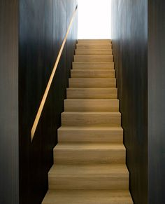 Beautiful staircase with build-in handrail by Holzrausch.