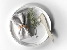 Plate with Napkin, Rosemary and Wooden Knife