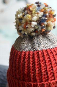 FREE hat knitting pattern Pom Pom It! By designer Stephen West - LoveKnitting
