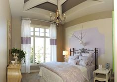 Create an Illusion: In a bedroom without large floor to ceiling windows, here's an example of how you can introduce your favorite purple in and make the space visually spread. I love the way nature touches the room in modern, and the whimsical ways with the lamp, and the deer head.