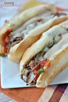 Easy, Saucy Cheesesteak Hoagies made with sliced deli meat and Ragu sauce! Dinner in under 20 minutes with this recipe!
