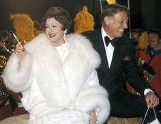 Lucille Ball looked noble in white gown along with Gary Morton after the party of the premiere of Mame in 1974