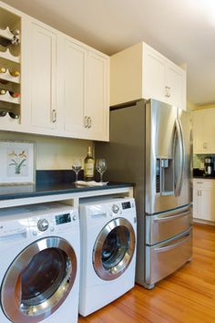 Washer and dryer integrated into the kitchen design for a small house