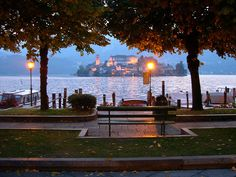 Orta San Giulio, oh I want to be sitting on that bench! Orta San Giulio is a town and comune in the Province of Novara in the Italian region of Piedmont, located about 100 km northeast of Turin and about 40 km northwest of Novara.