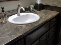 "Formica laminate ""Slate Sequoia"" was used for this bathroom vanity countertop. Basin Vanity Unit, Bathroom Countertops, Bathroom Vanity Countertops, Vanity, Vanity Countertop, 180fx, Countertops, White Bowls, Bathroom"