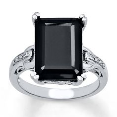 This delightfully Deco emerald-cut onyx ring is set in sterling silver with diamond accents.  Black Onyx is subject to a dye treatment which may not be permanent.  Gently clean by rinsing in warm water and drying with a soft cloth.