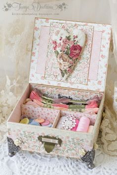 Inside the Sewing Box - lots of sewing goodies and a rosey heart pin cushion.