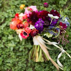 Bouquet of pincushion proteas, dahlias, ranunculuses, stock, peonies, veronica, jasmine, scabiosas, spray roses, and anemones, $200, Stems of Dallas