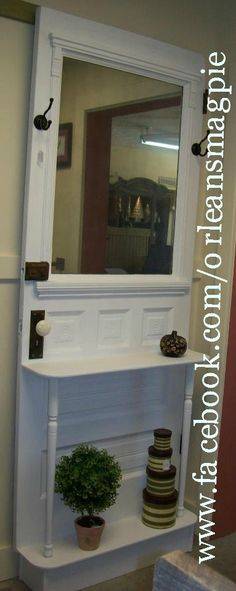 One of our creations!! Door repurposed into a hall tree. www.facebook.com/orleansmagpie