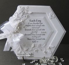 handmade card ... White On White ... hexagon shape with  many layers creating lots of texture... die cut decorations ...